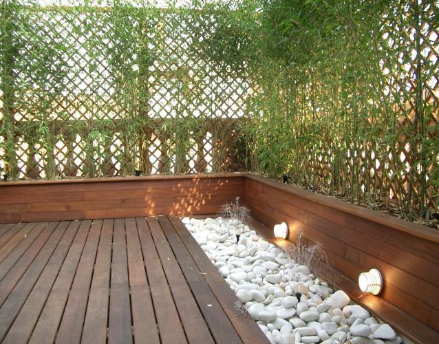 terraza en barcelona madera tropical jardineras y tarima